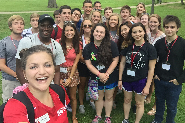 Gabby Casola takes a selfie with some of the students she leads as part of IU's New Student Orientation program.
